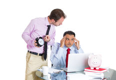 Businessman boss having an argument with his employee over a project he is working hard on, being pressured by lack of time Stock Photo