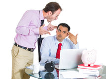 Businessman boss yelling having an argument with his employee over a project he is working hard on, and about to explode Stock Photos