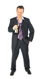 Businessman with bottle of wine Royalty Free Stock Images