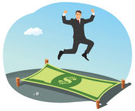 Businessman bouncing on a dollar Stock Image