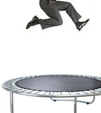 Businessman bouncing on a trampoline on white. A businessman banker having fun bouncing on a trampoline  on white Stock Photos