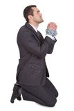 Businessman bound in chains begs for freedom Royalty Free Stock Photos