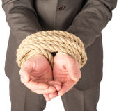 Businessman bound with rope Stock Photography