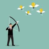 Businessman with a bow and arrow hitting the light bulb fly Stock Photos