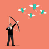 Businessman with a bow and arrow hitting the money fly Royalty Free Stock Photography