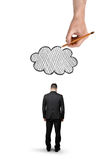 Businessman with bowed head standing and big hand above that draws cloud, isolated on white background Stock Photo