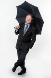 Businessman with bowler hat & brolly - on white Stock Image