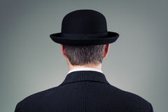 Businessman in bowler hat. Concept for business, finance, insurance and english culture stock photography