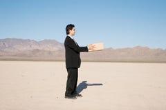 Businessman with a box Stock Photos