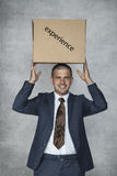 Businessman with a box of experience Royalty Free Stock Images