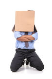 Businessman with box head Stock Images