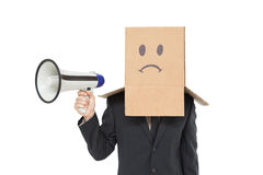 Businessman with box on head holding megaphone Royalty Free Stock Photos