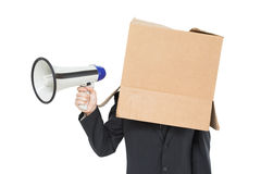 Businessman with box on head holding megaphone Stock Images