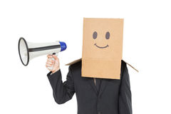 Businessman with box on head holding megaphone Royalty Free Stock Images