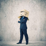 Businessman with box on head Stock Photo