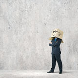Businessman with box on head Stock Image