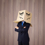 Businessman with box on head Stock Photos