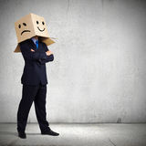 Businessman with box on head Stock Photography