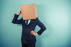 Businessman with a box on his head is cofused Royalty Free Stock Photos