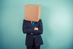Businessman with a box on his head Royalty Free Stock Image