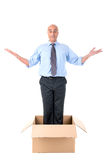 Businessman in a box Royalty Free Stock Photos