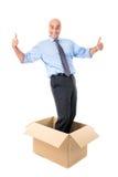 Businessman in a box Stock Photos