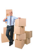 Businessman with boxes Stock Photos