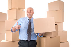 Businessman with boxes Stock Photo