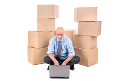 Businessman with boxes Royalty Free Stock Images