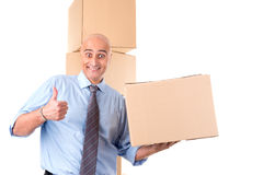 Businessman with boxes Royalty Free Stock Photography