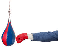 Businessman with boxing glove punches punching bag Stock Image
