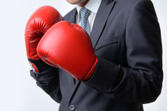 Businessman with boxing glove ready to fight with problem, busin. Businessman with red boxing glove ready to fight with problem, business concept Stock Photography