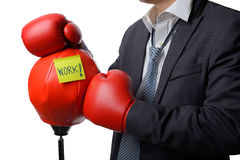Businessman with boxing glove ready to fight with work, business Stock Photo