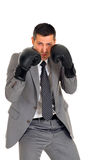 Businessman with boxing gloves Stock Photos