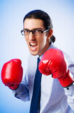 Businessman with boxing gloves Stock Photo