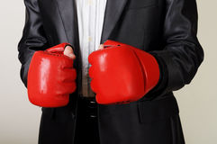 Businessman with boxing gloves. Businessman with red boxing gloves Stock Photos