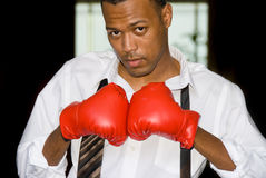 Businessman and boxing gloves Royalty Free Stock Images