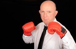Businessman with boxing gloves Royalty Free Stock Photography