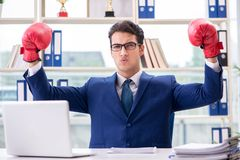 The businessman with boxing gloves angry in office Stock Photography