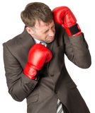 Businessman with boxing gloves defending Royalty Free Stock Photos