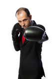Businessman with boxing gloves in fighting stance Stock Photos