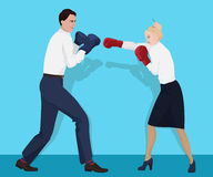 Businessman in boxing gloves having a fight with businesswoman. Fighting business partners. Stock Photography