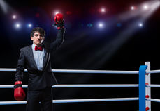 Businessman with boxing gloves in the ring. Image of a businessman with boxing gloves in the ring, the competition in the business Royalty Free Stock Photo