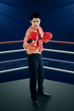Businessman with boxing gloves in the ring Stock Photo