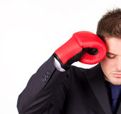 Businessman with boxing gloves to his head Royalty Free Stock Photo
