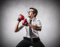 Businessman boxing royalty free stock photo