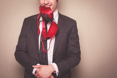Businessman with bra in his mouth Stock Photography