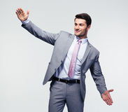 Businessman bragging about the size of something Royalty Free Stock Image