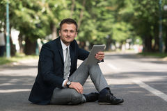 Businessman On A Break With His Computer Royalty Free Stock Photo