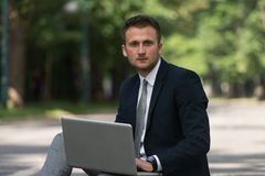 Businessman On A Break With His Computer Royalty Free Stock Photos